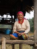Karen hill tribe sitting on her hut Stock Image