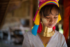 Karen long necked tribe woman weaves on a loom in hills near Chiang Mai, Thailand Stock Image
