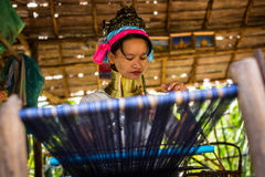 Karen long necked tribe woman weaves on a loom in hills near Chiang Mai, Thailand Royalty Free Stock Photography