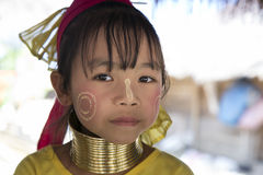 Karen Tribe girl, Thailand. Chang Rai, Thailand - January 8, 2016: Karen Hill tribe girl showing the gold neck rings and gold facial painting. Girls start with a stock image