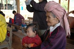 Karen tribe grandma with granddaughter in arm Royalty Free Stock Photo