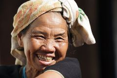 Karen woman laughing. Close portrait of a mature Karen tribe woman laughing, Thai ethnicity, in the village of  Bam Muang Pam, north Thailand on November 22 Royalty Free Stock Photo