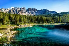 Karersee Lago di Carezza, is a lake in the Dolomites in South Tyrol, Italy. In the background the mountain range of the Latemar royalty free stock photography