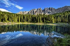 Karersee Lago di Carezza, is a lake in the Dolomites in South Tyrol, Italy.In the background the mountain range of the Latemar g royalty free stock photos
