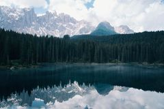 The Karersee lake with reflection of mountains in the Dolomites. stock images