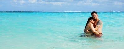 karibisk omfamning Arkivfoto