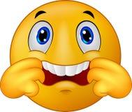 Karikatur Emoticonsmiley, der ein neckendes Gesicht macht Stockfotos