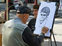 Karikaturenzeichner typisch Stockbild