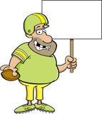 Karikaturfußballspieler, der ein Zeichen hält Lizenzfreies Stockbild