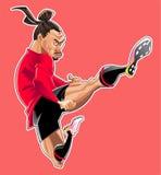 Karikaturfußballspieler springen Tritt lizenzfreie stockfotografie