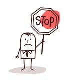 Karikaturgeschäftsmann, der ein Stoppschild hält Stockbild