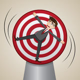 Karikaturgeschäftsmann zugeschlossen auf spinnendes Ziel Stockfotos