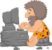Karikaturhöhlenbewohner, der einen Steincomputer verwendet vektor abbildung