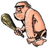 Karikaturhöhlenbewohner mit einem Klumpen Lizenzfreies Stockfoto
