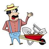 Karikaturlandschaftsgestalter mit Schubkarre und Gartenwerkzeugen Lizenzfreie Stockfotografie