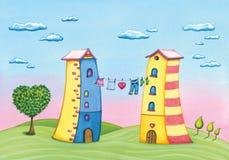 Karikaturliebeshäuser mit Wäscheleine und einem Liebesbaum Stockfotos