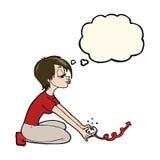 Karikaturmädchen, das Computerspiele mit Gedankenblase spielt Stockfotografie