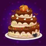 Karikaturschokolade und ein großer Kuchen für Halloween-Partei Lizenzfreie Stockfotos