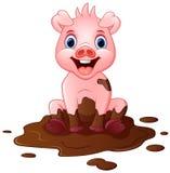 Karikaturschweinspiel in einer Schlammpfütze Stockfotos