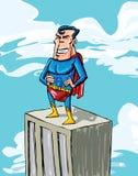 Karikatursupermann auf eine Gebäudeoberseite Stockfoto