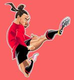 Karikatyrfotbollspelaren hoppar spark royaltyfri fotografi