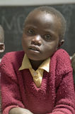 Karimba School with close up of young student in new classroom in North Kenya, Africa Royalty Free Stock Photo