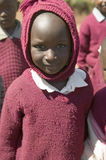 Karimba School with closeup of young girl in maroon sweater in North Kenya, Africa Stock Photo