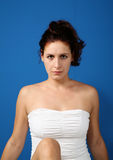 Karin. Girl with a white clothes on blue background royalty free stock photo