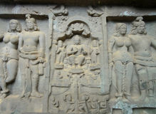 Karla Caves Chaityagriha, Sanctum Sanctorum, Budha Sculpture flanked by other dieties in Front Veran Stock Photos