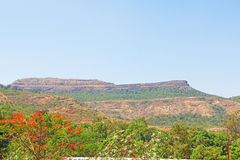 Karla caves india. Ancient caves and ruins viewed from afar Royalty Free Stock Photos