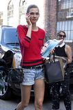 Karlie Kloss looking at her cellphone in Manhattan New York City royalty free stock images