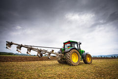 Karlovo, Bulgaria - August 22th, 2015: Ploughing a field with Jo. Hn Deere 6930 tractor. John Deere 8100 was manufactured in 1995-1999 and it has JD 7.6L or 8.1L Stock Images