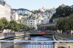Karlovy Vary - World Spa. Karlovy Mary, CZECH REPUBLIC - AUGUST 14: World Spa with many healing springs. View to the center with colonnade and many tourists, in Royalty Free Stock Photography