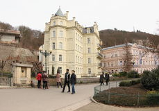 Karlovy Vary Buildings. Tourists walking in Karlovy Vary among beautiful old buildings. A popular resort known as the Spa Town in Czech Republic, Central Europe Stock Photo