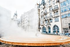 Hot spring Vridlo, Karlovy Vary, Czech, industrial style. KARLOVY VARY, CZECH REPUBLIC – NOVEMBER 1, 2018: Hot spring Vridlo and Church of Saint Mary royalty free stock images