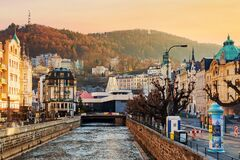 Free Karlovy Vary, Czech Republic - April, 2018: Houses In City Center Of Karlovy Vary On The Tepla River During Sunrise. Karlovy Vary Royalty Free Stock Images - 184891929