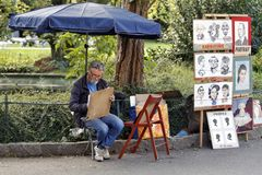 Karlovy Vary, Czech Republic - Folk Cartoonist. KARLOVY VARY, CZECH REPUBLIC - AUGUST 14: In the streets you can be painted or have a cartoon from folk artists Stock Images