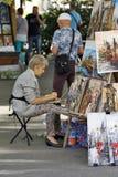 Karlovy Vary, Czech Republic - Folk Artist. KARLOVY VARY, CZECH REPUBLIC - AUGUST 14: In the streets you can find a lot of folk artists with diffrent types of Stock Photos