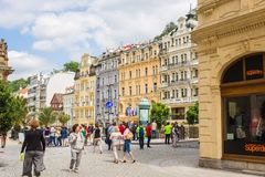 KARLOVY VARY, CZECH REPUBLIC - JUNE 13, 2017: The people walking on at center with facades of old buildings at Karlovy royalty free stock photos