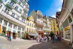 KARLOVY VARY, CZECH REPUBLIC - MAY 26, 2017: Tourist group walki Stock Photography