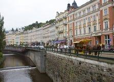 KARLOVY VARY, CZECH REPUBLIC - SEPTEMBER 14, 2014: tourists walk along the Tepla river on September 14, 2014 in Karlovy Vary, Czec Royalty Free Stock Photo