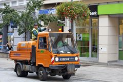 Karlovy Vary, Czech Republic - World Spa. Karlovy Vary, CZECH REPUBLIC - AUGUST 17: Worker municipal service takes care of flowers arrangements in the summer Stock Image