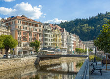 Karlovy Vary landscape. Karlovy Vary, Czech republic - July 18, 2016: Tepla River with fountains and Promenade street in Karlovy Vary, Czech republic, July 18 royalty free stock photos