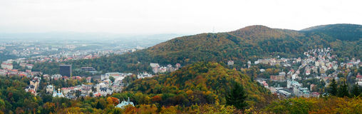 Karlovy Vary Panorama, Czech Republic. A panoramic view of Karlovy Vary in autumn with red orange and yellow trees, Czech Republic stock photo