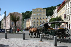 Karlovy Vary street view. Horse carriage in Karlovy Vary (Carlsbad) Popular Resort in Czech Republic Stock Images