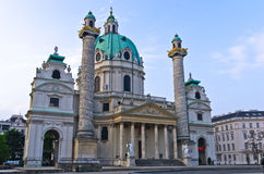Karlskirche or saint Charles church exterior at sunrise in Vienna Stock Image