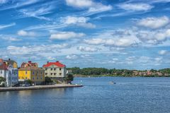 KARLSKRONA, SWEDEN - 2017 July. Typical red Swedish wooden houses with natiaonal flag in the city of Karlskrona Stock Image