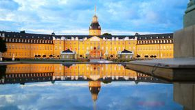 Karlsruhe German Palace at dusk reflected in the fountain 4k footage.  stock video footage