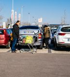 Family shopping for food in Kaufland supermarket parking royalty free stock image