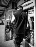 Male service operator repairing the train ticket fahrkarte vendi Royalty Free Stock Image